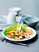Tandoori prawns and grilled squid rings with limes