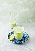 Avocado, cucumber and celery smoothie with herbs and lemon