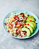 Bulgur salad with avocado, tomatoes, pomegranate seeds and feta cheese