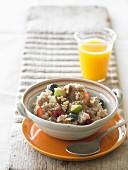 Porridge with fruit and orange juice