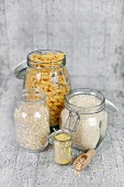 Pasta, rice and grains in storage jars