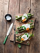 Bruschetta topped with asparagus and poached egg