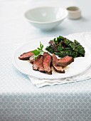 Flank steak with leafy greens
