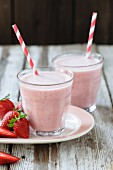 Fruit Smoothie in Glass with Drinking Straw Garnished with Strawberry