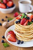 A stack of pancakes with fresh berries