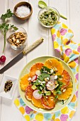 Orange salad with radishes, avocado and walnuts