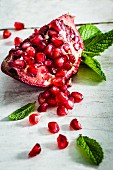 A piece of pomegranate and fresh mint