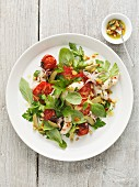 Squid salad with tomatoes and olive dressing