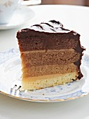 A slice of almond and chocolate cake