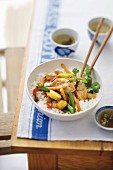 Chicken stir-fry with vegetables, pineapple, ginger and chilli on rice (Asia)