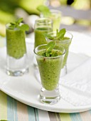 Cold pea and mint soup in shot glasses