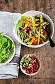 Pasta salad with fresh vegetables and goji berries