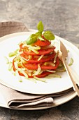 A stack of tomatoes with celery