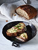 Cheese and pear on toast with chives