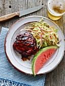 Grilled chicken with coleslaw and watermelon