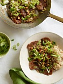 Stir-fried pork with Chinese cabbage, spring onions and rice
