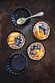 Tartlets with berry mascarpone, blueberries and apricots