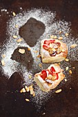 Sweet yeast dough cakes with berries and flaked almonds