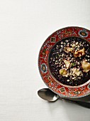 Black rice dessert with apple and lime