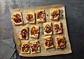 Puff pastry slices with caramelised onions, brie and walnuts