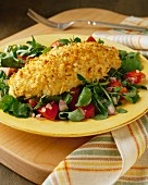 Breaded haddock on a mixed salad