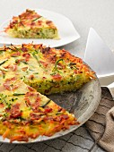 Courgette quiche with bacon, sliced