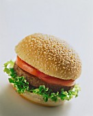 A veggie burger with tomato and lettuce