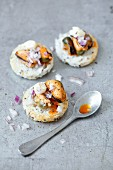Toasts with mussel and red onion