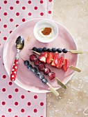 Berry skewers with a vanilla and honey dip