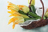 Courgettes with flowers in a wicker basket