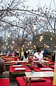 People seating outside at a restaurant (Asia)