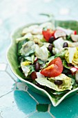 A mixed salad with tomatoes and chilli beans