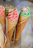Ice cream cones with meringue and sugar flowers