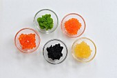 Various types of caviar in glass bowls