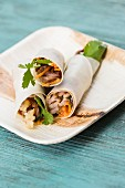 Duck wraps on a palm leaf plate