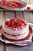 Pavlova with strawberries, raspberries and pistachios