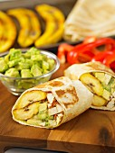 Wraps filled with plantains, avocado and tofu