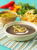 Black bean soup with tortilla strips and sour cream