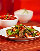 Szechuan beef with pepper and mange tout