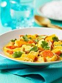 Winter vegetable stew with coconut and cashew nuts
