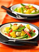 Yellow curry with tofu, pineapple and peas
