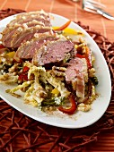 Duck breast on a bed of braised savoy cabbage with a pepper and walnut medley