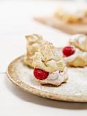 Mini profiteroles with raspberry cream