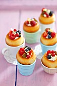Baba au rum with whipped cream and berries