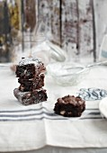 Chocolate brownies with nuts and icing sugar
