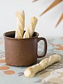 Breadsticks in an old mug