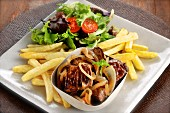Steak with onions, salad and chips