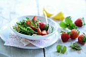 Herb salad with fresh strawberries