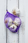 Bulbs of garlic in a net