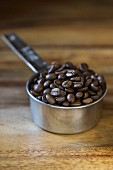 Coffee beans in a measuring cup